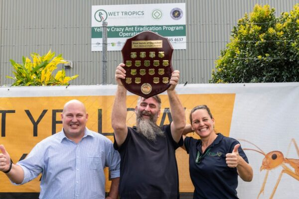 From left the Honourable Curtis Pitt Member for Mulgrave, Gareth Humphries and Lucy Karger from Wet Tropics Management Authority pictured with the Queensland Pest Animal Award.
